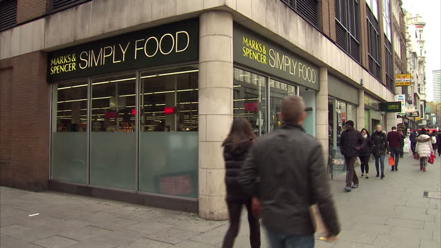 Exterior shots of Marks Spencer simply food shop customers walking into the store on November 8 2016 in London England
