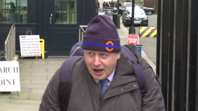 Exterior shots of Mayor of London Boris Johnson walking out of Downing Street wearing a TFL beanie hat and wheeling a bicycle reporters ask him 'EU...