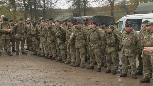 Exterior shots of members of the 3rd UK Division assembled for a field service on Salisbury Plain to comemmorate Armistice Day on November 11 2017 in...