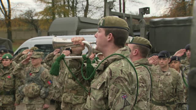 Exterior shots of members of the 3rd UK Division marking Armistice Day during exercises on Salisbury Plain including shots of soldiers saluting as a...