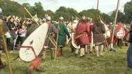 Exterior shots of men in Anglo Saxon and Norman military uniforms reenacting the 1066 Battle of Hastings as part of the 950th anniversary on October...