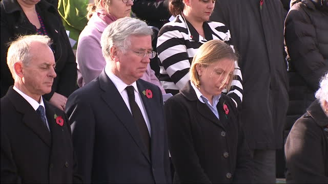 Exterior shots of Michael Fallon MP Defence Secretary stood for two minute silence in a memorial service in Aylesford on Armistice Day next to...