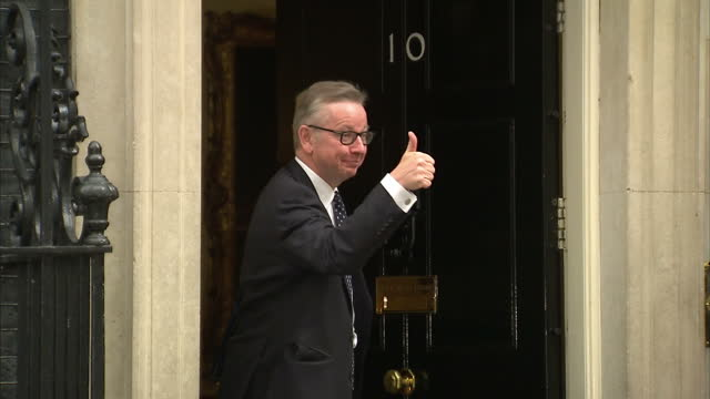 Exterior shots of Michael Gove MP Justice Secretary knocking on the door to Number 10 and posing with his thumbs up on July 05 2016 in London England