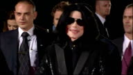 Exterior shots of Michael Jackson on red carpet of World Music awards speaking to press but impossible to hear with all the shouting and commotion...