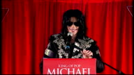 Exterior shots of Michael Jackson on stage of This Is It press conference and starts to talk as crowd go wild and MJ gets excited as he announces...