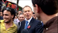Exterior shots of Middle East Peace Envoy Tony Blair walking on a tour of Jenin meeting local people and giving a short statement about not running...