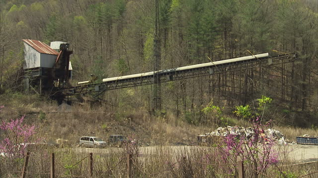 Exterior shots of mining equipment and coal mine trucks laden with coal driving at a Kentucky coal mine on 20 April 2017 in Hazard Kentucky