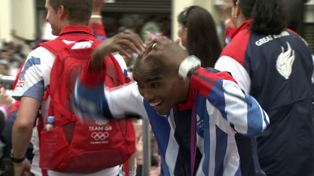 Exterior shots of Mo Farah Double Olympic Champion performing MoBot on London 2012 Parade bus to crowd London 2012 Olympic and Paralympic Parade on...