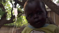 Exterior shots of mothers young children waiting for medical attention at a women's clinic in Southern Sudan Southern Sudan's 2010 bid for...