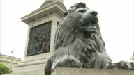 Exterior shots of Nelson's Column in Trafalgar Square including close up shots of one of the bronze lions at the base of the monument and a bronze...