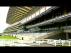 Exterior shots of new empty spectators stand at Ascot race course Exterior shots of people in stands Close up of winning post with blurred vision of...