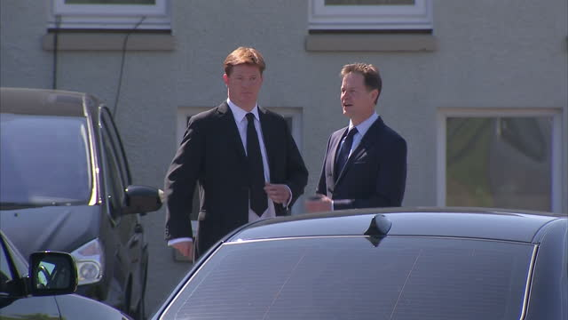 Exterior shots of Nick Clegg and Danny Alexander speaking together at the funeral of former Liberal Democrat Leader Charles Kennedy>> on June 12 2015...
