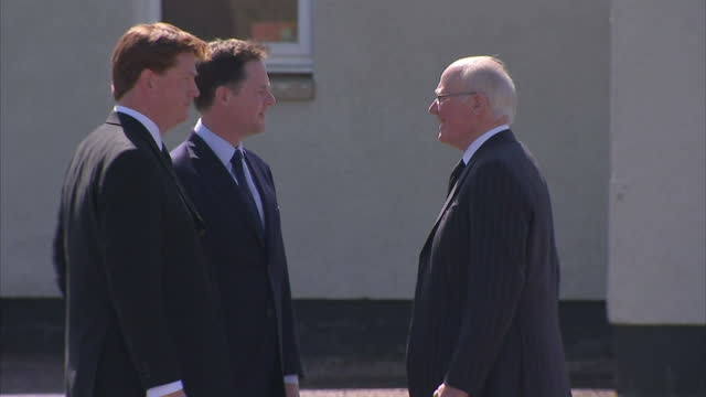 Exterior shots of Nick Clegg Danny Alexander and Sir Menzies Campbell speaking together at the fineral of former Liberal Democrat Leader Charles...