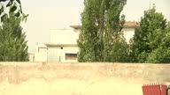 Exterior shots of Pakistani police guarding the hideout of AlQaeda leader Osama Bin Laden's villa grounds in Abbottabad on in Abbottabad Pakistan
