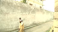 Exterior shots of Pakistani policeman guarding the hideout of AlQaeda leader Osama Bin Laden in Abbottabad Exterior shots of the villa on in...