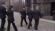 Exterior shots of people arriving at Glasgow Cathedral for a memorial service marking the anniversary of the Clutha helicopter crash including Jim...