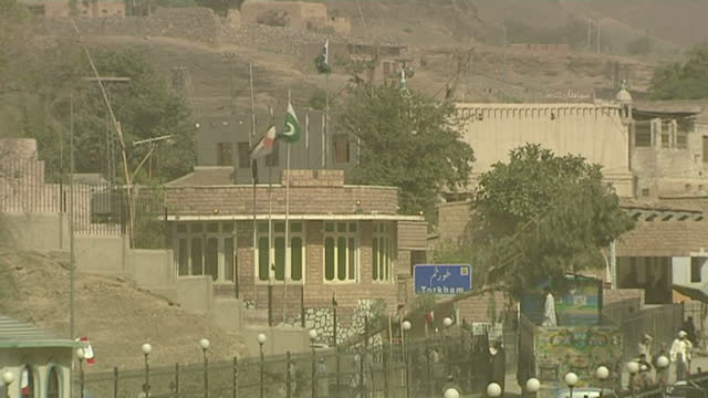 Exterior shots of people arriving at the Torkham border from Afghanistan into Pakistan in Landi Kotal Security forces refuse entry to a couple...