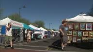 Exterior shots of people browsing various arts and crafts stalls at a craft fair on 4 November 2016 in Mesa Arizona United States