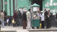 Exterior shots of people buying food at the roadside from street vendor in Lima Peru People buying food from street vendor in Lima on August 21 2013...