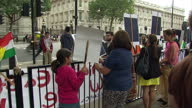 Exterior shots of people demonstrating in Whitehall holding up placards protesting about the killings of Yazidi people in Iraq>> on August 13 2014 in...
