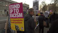 Exterior shots of people holding up banners at an antiIslamophobia rally on March 25 2017 in London England