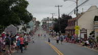 Exterior shots of people lining the streets awaiting an Independence Day parade on 4 July 2016 in Leesburg VA United States
