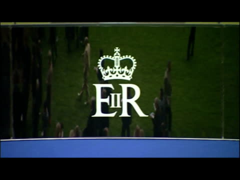 Exterior shots of people queueing to place bets and standing in viewing enclosure Close up of Queen's ERII logo on glass reflecting people in...