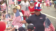 Exterior shots of people reading the prayer of allegiance during a fourth of July carnival parade on 4 July 2016 in Los Angeles United States