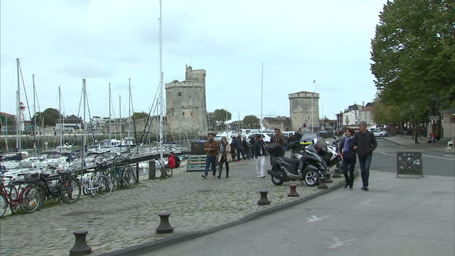 Exterior shots of people relaxing and eating lunch around La Rochelle harbour on 31 October 2017 in La Rochelle France