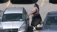 Exterior shots of people suffering from obesity Shot in a shopping mall parking lot People walking to the stores and their vehicles The Obesity...