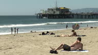 Exterior shots of people sunbathing on Santa Monica beach on April 07 2014 in Los Angeles California