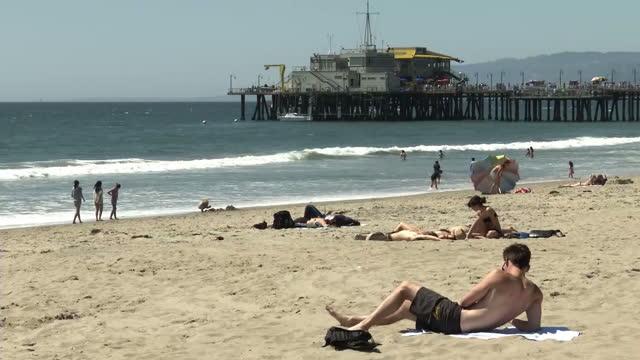 Exterior shots of people sunbathing on Santa Monica beach on April 07 2014 in Los Angeles California