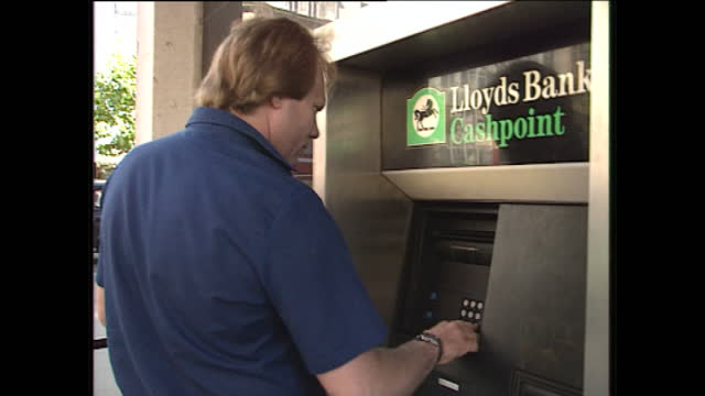 Exterior shots of people using ATM machines outside National Westminster Bank aka Natwest and Lloyds on August 21 1989 in London England