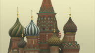 Exterior shots of people walking in Red Square including views of St Basil's Cathedral and State Historical Museum>> on April 04 2016 in Moscow Russia