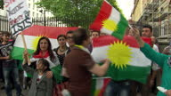 Exterior shots of people waving Kurdish flags and chanting during a protest against the killings of Yazidi people in Iraq>> on August 13 2014 in...