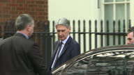 Exterior shots of Philip Hammond MP Chancellor of the Exchequer departing 10 Downing street and entering car ignores press questions re triggering...