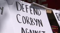 Exterior shots of placards at a Spartacist League of Britain stall during the May Day rally in London with slogans criticising Jeremy Corbyn for his...