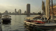 Exterior shots of pleasure boats moored at a jetty on the River Nile and general river traffic passing on January 29 2015 in Cairo Egypt