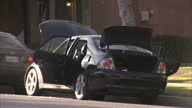 Exterior shots of police activity outside the house of the San Bernardino terror killers Rizwan Farook and Tashfeen Malik with a Lexus car with the...