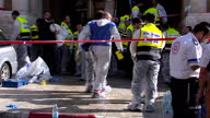 Exterior shots of police and forensic detectives outside a Jerusalem synagogue at which four worshipers were killed collecting evidence from the...