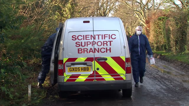 Exterior shots of police and forensics investigators searching ditches and the area near the house where the body of Valerie Graves was found Police...