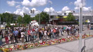 Exterior shots of police and mourners at the scene of yesterday's terror attacks in Munich in which nine people were killed by a teenage gunman with...