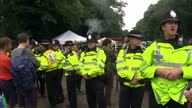 Exterior shots of Police and protesters facing each other in non violent stand off and protesters singing songs Protesters and police at Balcombe...