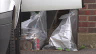 Exterior shots of police at Al Hilli family home removing evidence in boxes and clear plastic bags taking it away for inspection Police continuing...