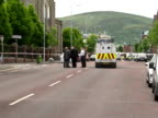 exterior shots of police cordon along Shankill Road after a man was gunned down at point blank range in front of lunchtime shoppers Exterior shots of...