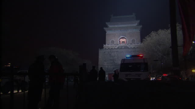 Exterior shots of police enforcing public safety in Beijing on New Year's Eve as crowds make their way to a fireworks display on February 14 2010 in...