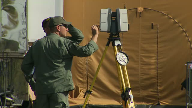 Exterior shots of police guarding and surveying the scene of the mass shooting attack on the First Baptist Church in Sutherland Springs including...