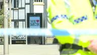 exterior shots of police guarding cordoned off crime scene the day after suicide bomber targeted Manchester arena in terror attack on 23rd May 2017...