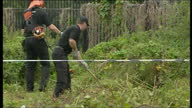 Exterior shots of police searching undergrowth near the scene of the murder of 11yearold Rhys Jones for clues on 24 August 2007 in Liverpool United...
