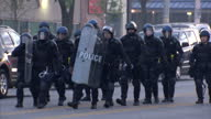 Exterior shots of police with riot shields and helmets in Baltimore in anticipation of violence from protesters on April 28 2015 in Baltimore Maryland